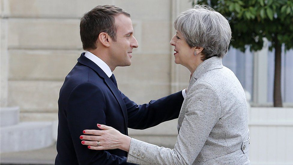File pic: French President Emmanuel Macron welcomes British Prime Minister Theresa May prior to a working dinner at the Elysee Presidential Palace on June 13, 2017