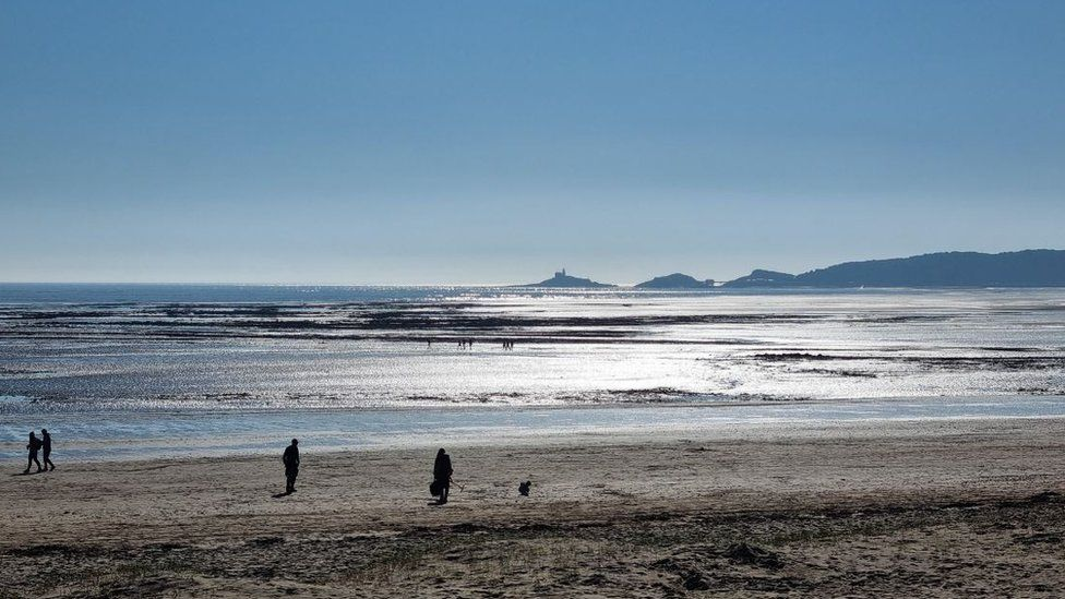 There were a few people enjoying the sunshine on the beach in Swansea on Sunday