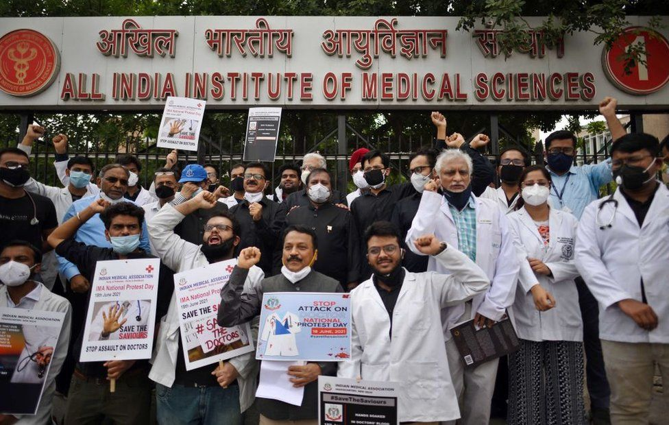 Members of Indian Medical Association (IMA) demonstrating with placards demanding a central law to protect doctors against violence, outside AIIMS on June 18, 2021 in Delhi, India.