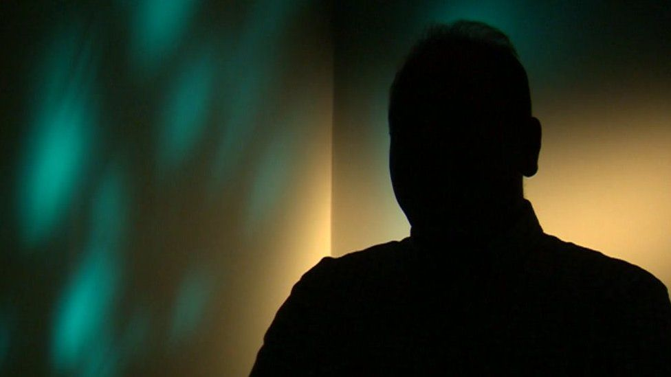 Silhouette of an adoptive parent speaking to the BBC