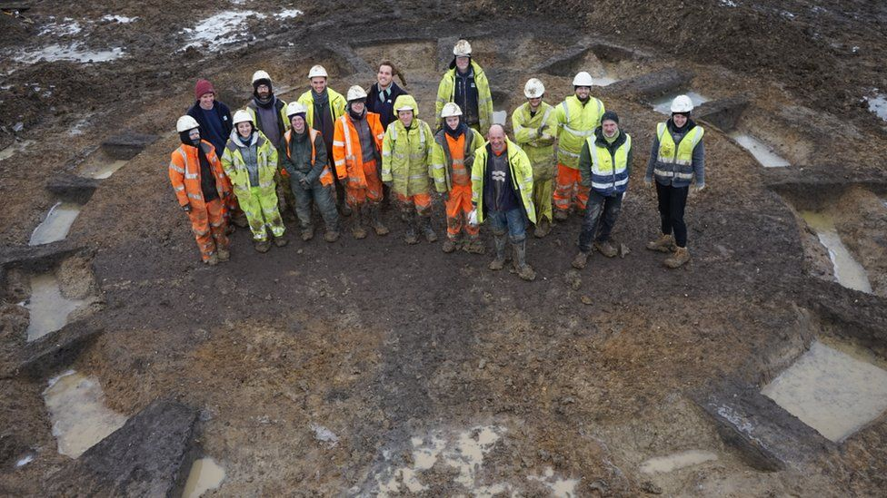Archaeologists standing in a roundhouse at Warboys dig