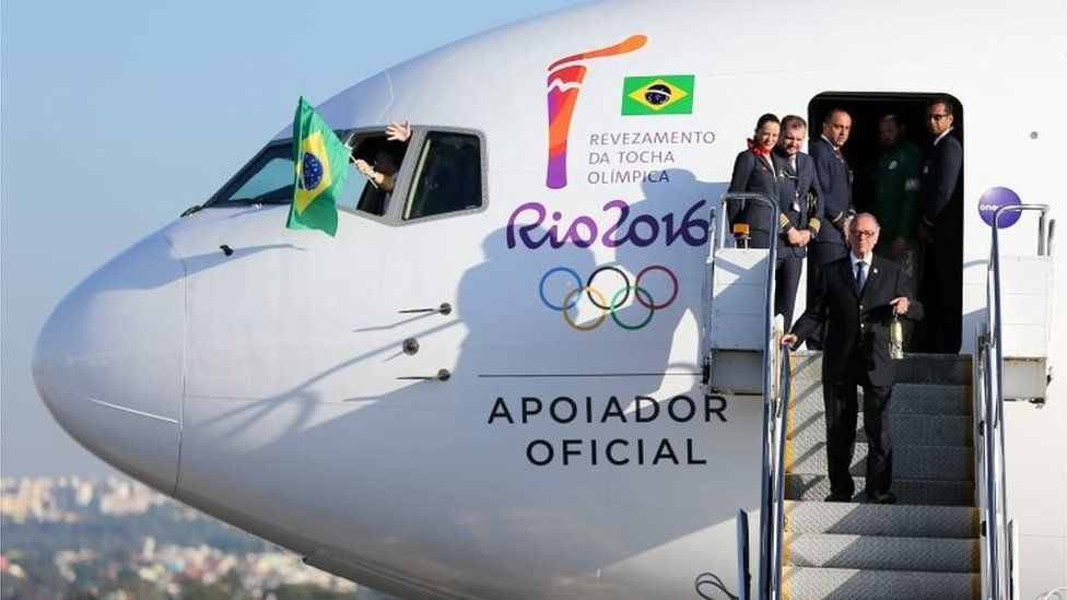 Carlos Arthur Nuzman , President of Rio 2016, steps from the plane with the Olympic flame arriving from Geneva, on May 3, 2016 in Brasilia, Brazil. The Olympic torch will pass through 329 cities from all states from the north to the south of Brazil, before arriving in Rio de Janeiro on August 5, for the lighting of the cauldron.