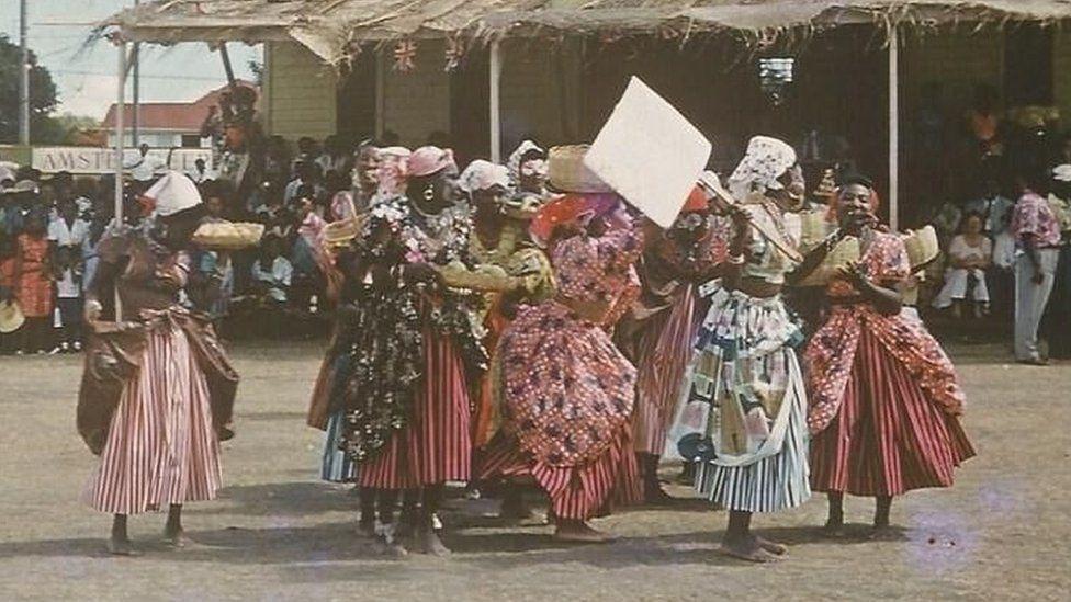 Women wearing plantation-era dresses attend the 1967 Carnival