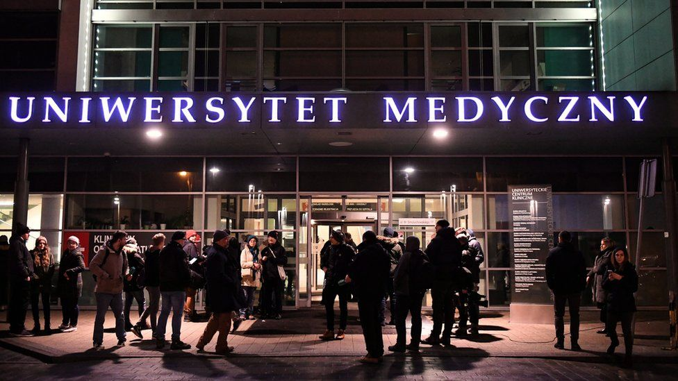 People gather at the entrance of the University Clinical Centre, in which the wounded Mayor of Gdansk Pawel Adamowicz is being treated
