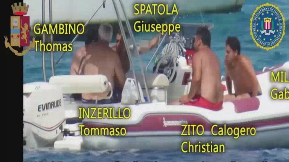 Police footage of suspects on a boat off Sicily