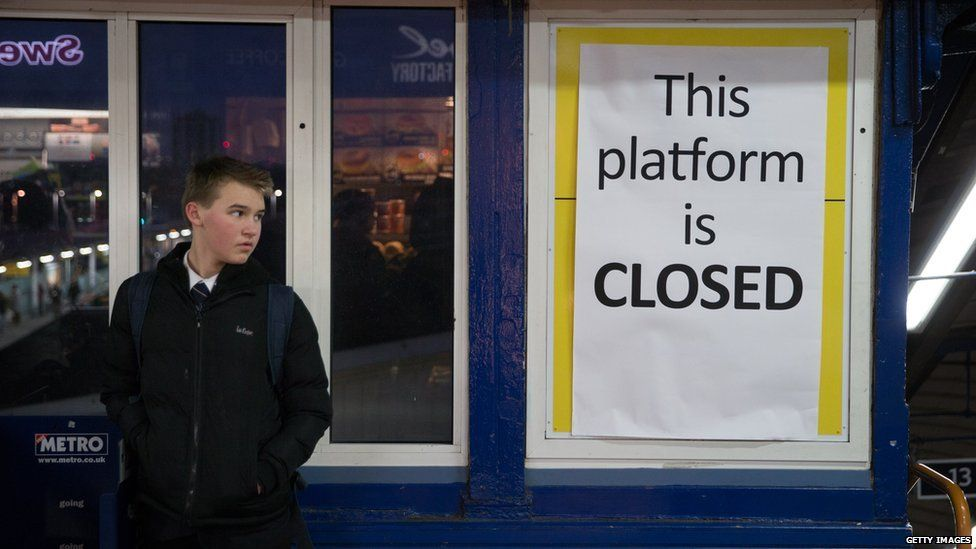 A student stands at a closed platform