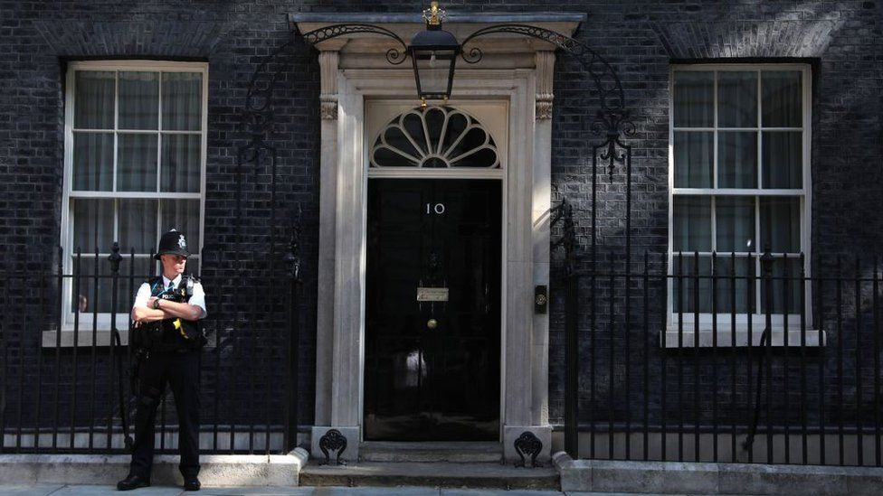 A policeman standing outside 10 Downing Street
