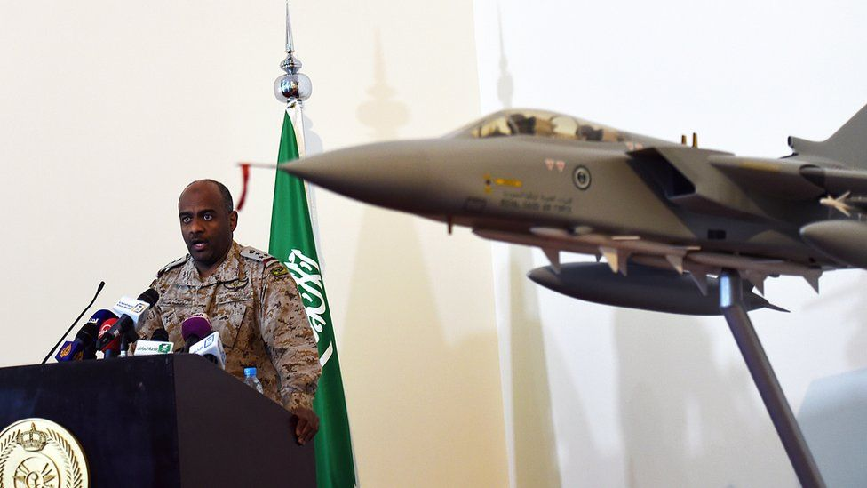 Saudi Brigadier General Ahmed Asiri, speaks to the media next to a replica of a Tornado fighter jet (March 2014)
