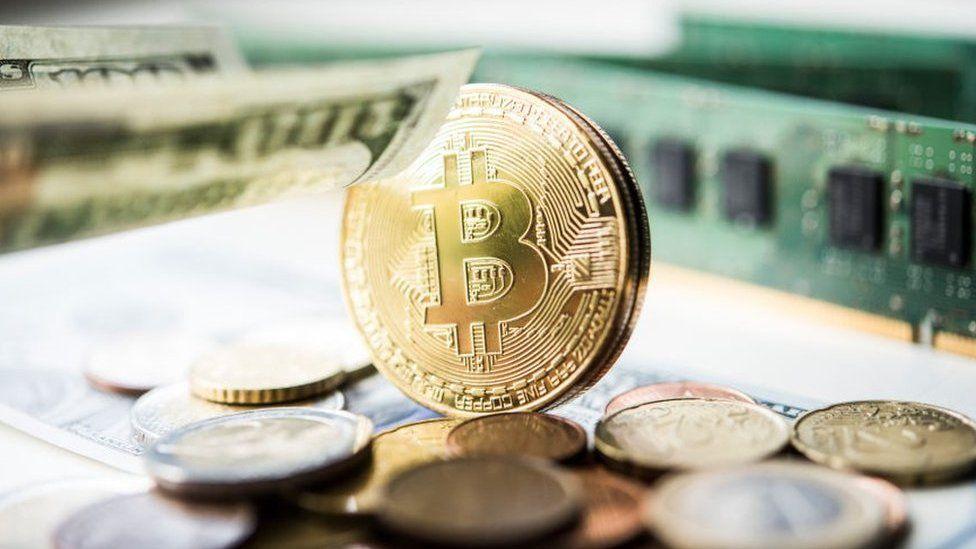 Bitcoin peaks at record high close to $20,000 - BBC News