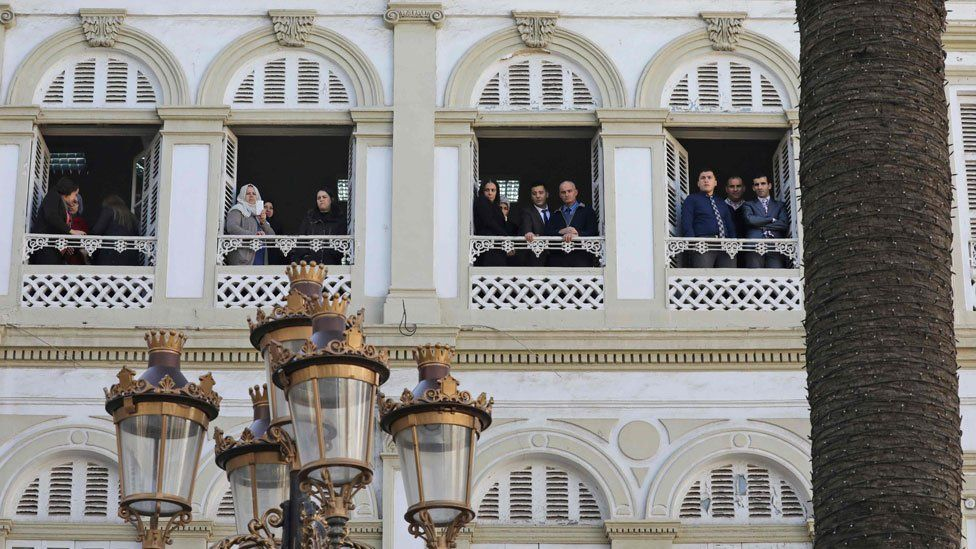People looking out of windows in Algiers, Algeria - Wednesday 6 December 2017