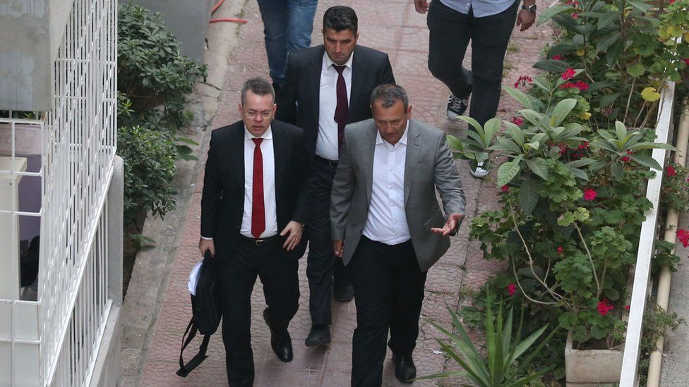 Pastor Brunson is escorted to his home in Izmir, after being freed.