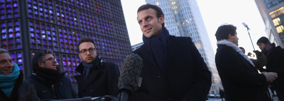 French presidential candidate Emmanuel Macron (c) talks to journalists in Berlin, on January 10, 2017