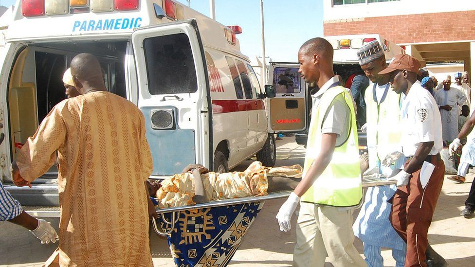 In this Wednesday, Feb. 10, 2016 file photo, rescue workers transport a victim of a suicide bomb attack at a refugee for treatment at a hospital, in Maiduguri, Nigeria.