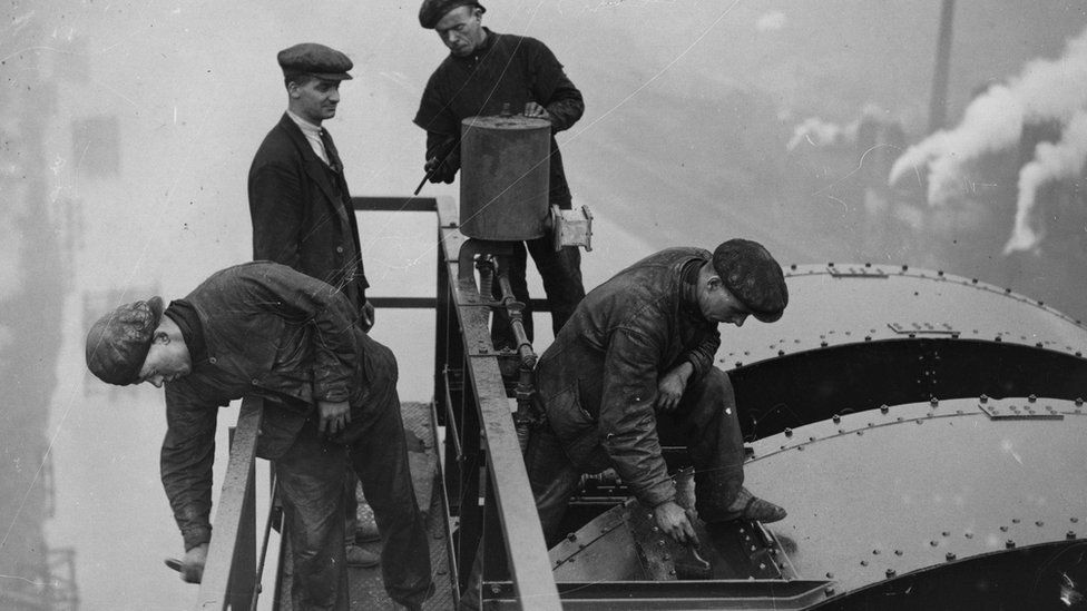 Four men paint the top of Newport Bridge in 1935