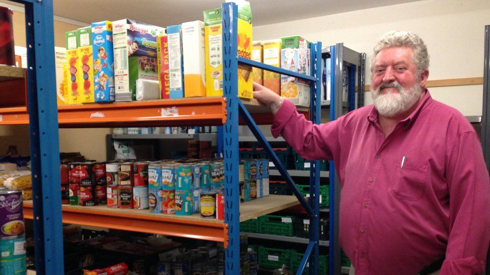 Neal Mellon in the store of the Isle of Man Foodbank