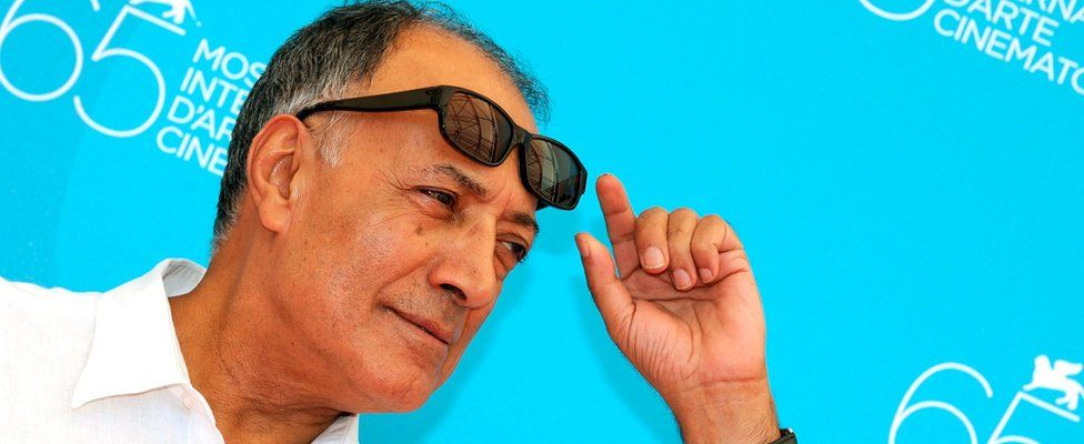 """A file picture dated 28 August 2008 shows Iranian director Abbas Kiarostami posing during a photocall for his movie """"Shirin"""" at the 65th annual Venice Film Festival,"""