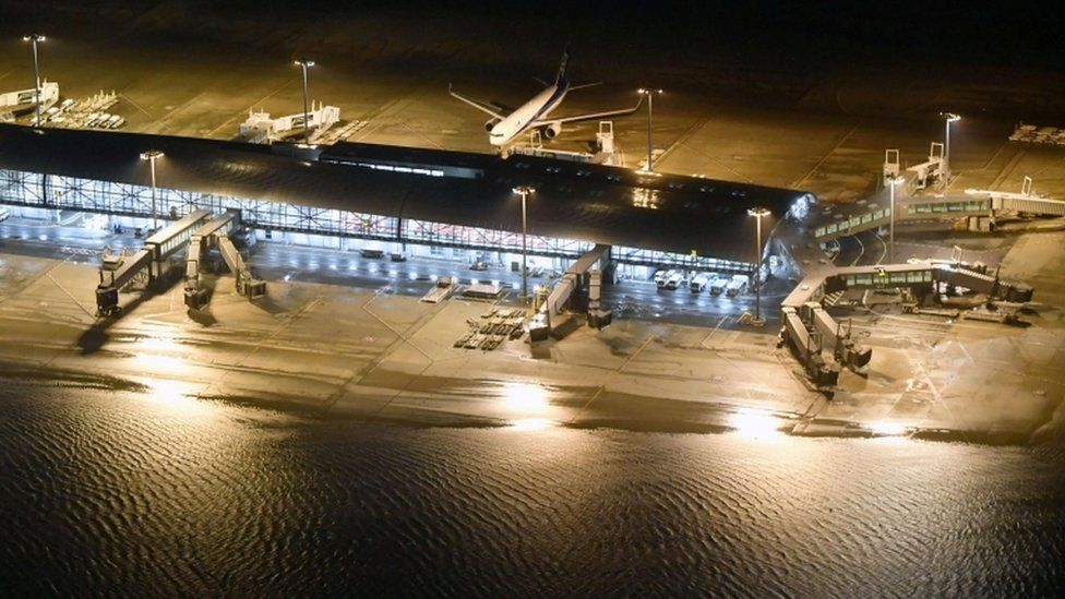 Runways were flooded at Kansai airport and its bridge to the mainland was damaged