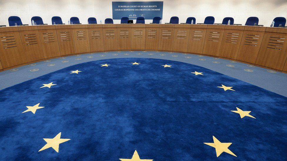 The chamber of the ECHR is seen in this file photo, with the European flag on the floor and seat for the panel in a circle around it