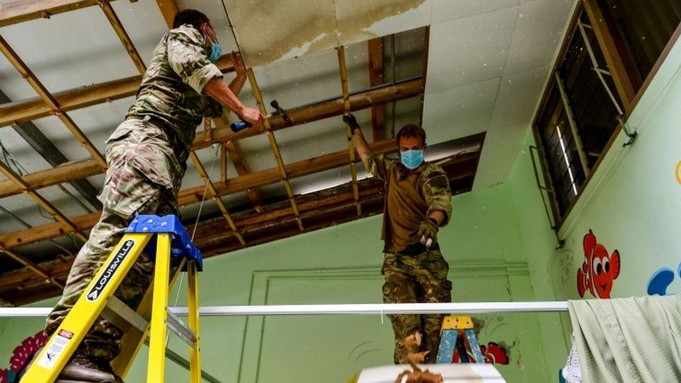 Royal Marines clearing up the damage at Princess Alexandra Hospital on the island of Anguilla
