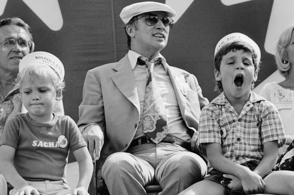 Justin Trudeau (right, yawning) grew up in a political family - his father Pierre (centre) was also PM