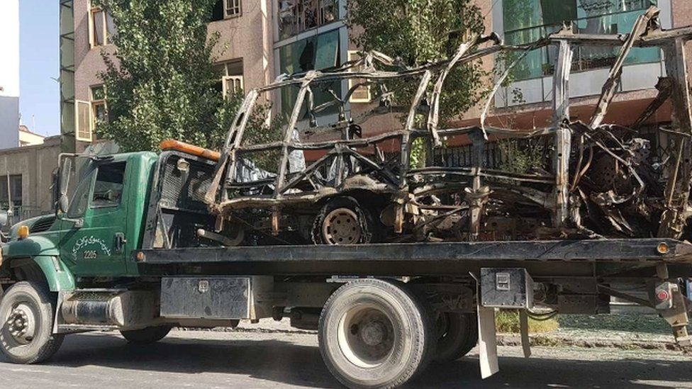 The shell of the bus is removed from the site, Kabul, Afghanistan
