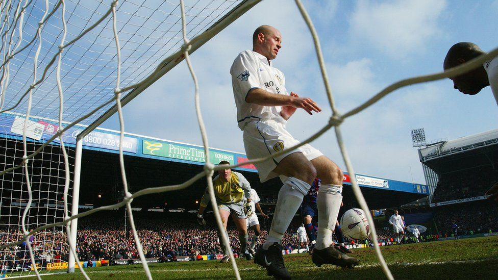 Michael Duberry and Danny Mills of Leeds United clear the goal