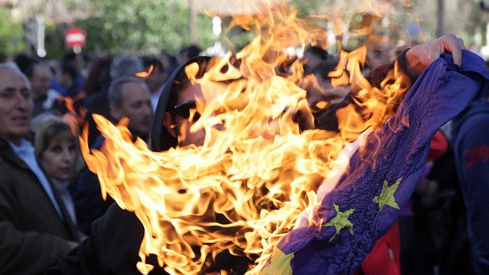 Protesters burning EU flag in Cyprus, 2013 file pic