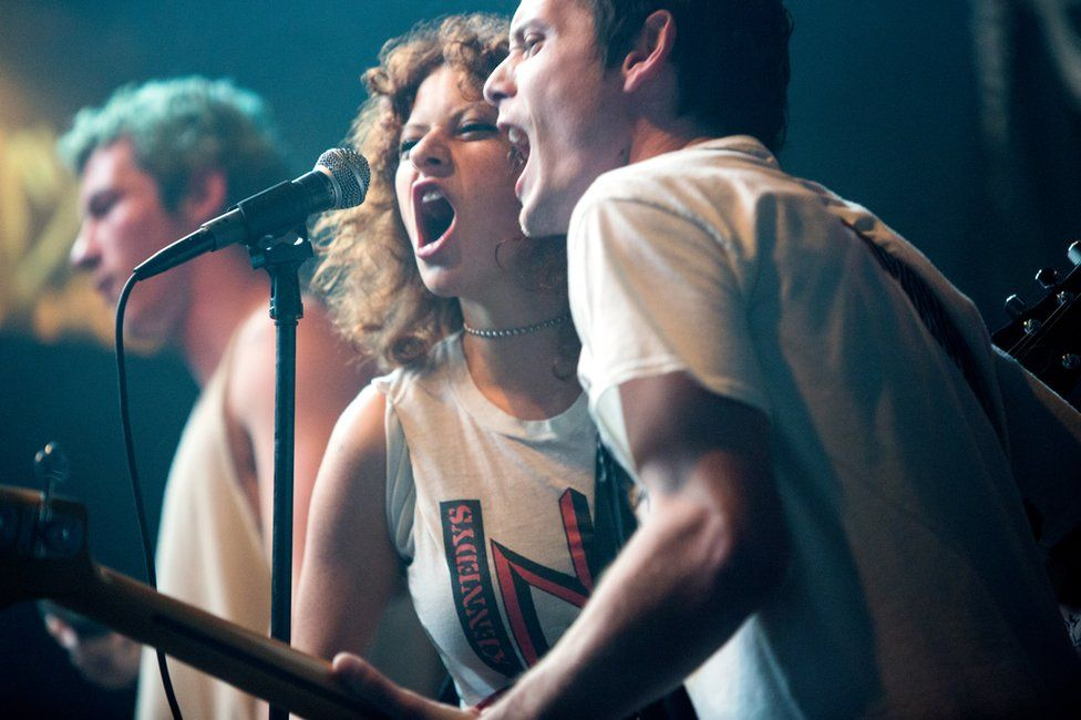 This image released by A24 Films shows Alia Shawkat and Anton Yelchin, right, in a scene from, Green Room