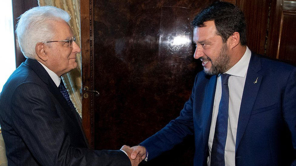 "Italy""s President Sergio Mattarella shakes hands with League leader Matteo Salvini in Rome"