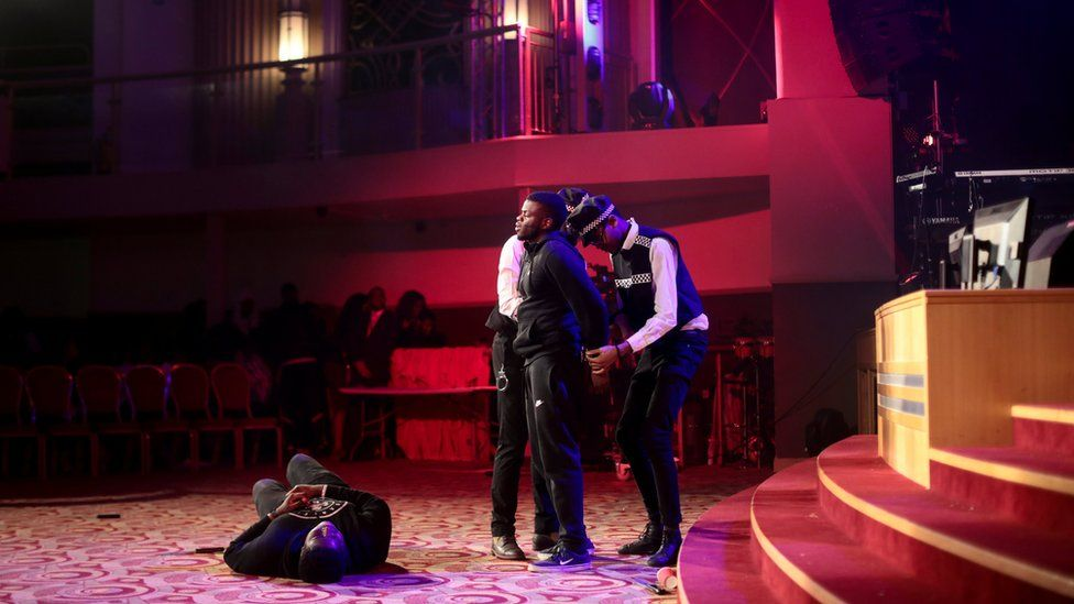 Members of the youth church perform in a knife crime play