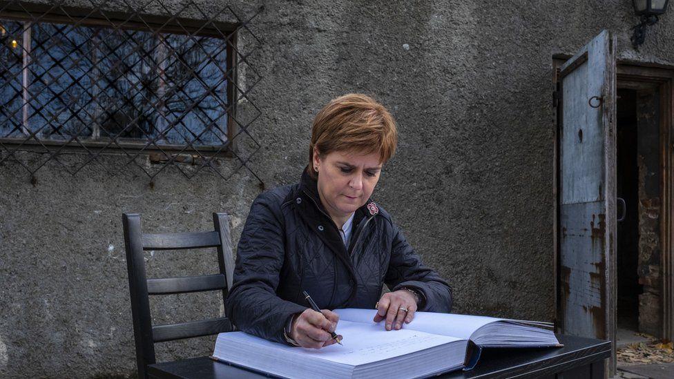 Nicola Sturgeon signs visitor book