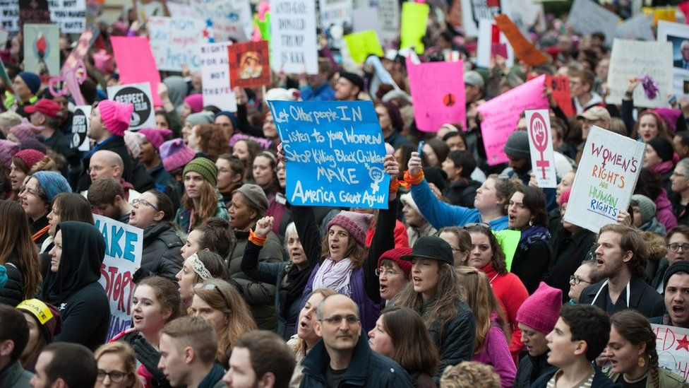 """People march along Independence Ave for the Women""""s March on Washington in Washington, DC, USA, 21 January 2017."""