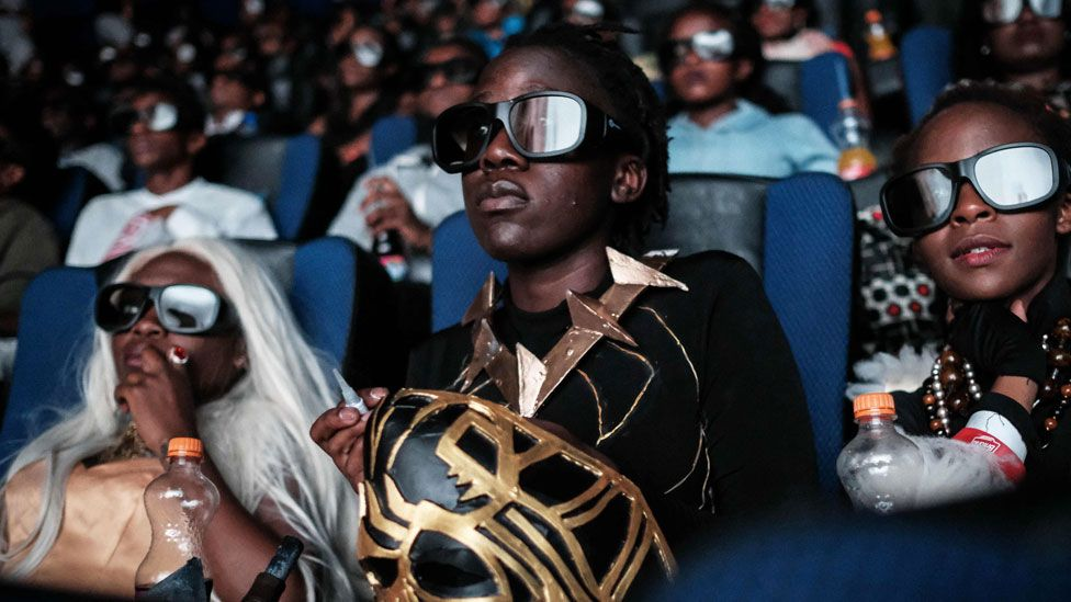 Cosplayers watch the film Black Panther in 3D during a screening in Nairobi, Kenya - 14 February 2018