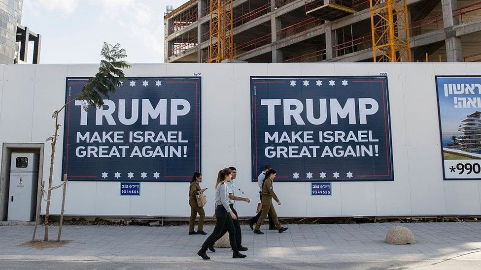 Placards reading Trump Make Israel Great Again are seen in the Israeli city of Tel Aviv