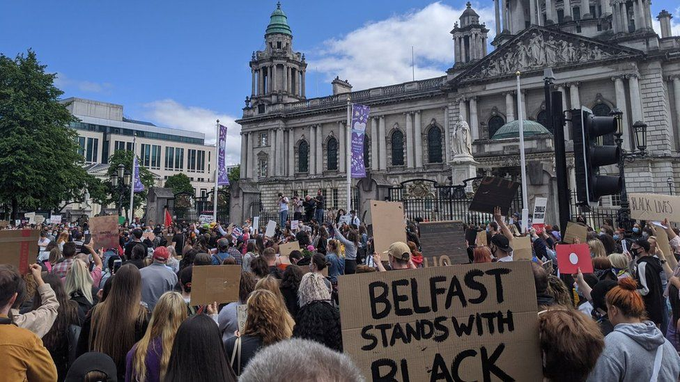 A large crowd has gathered at Belfast City Hall to protest over the death of George Floyd