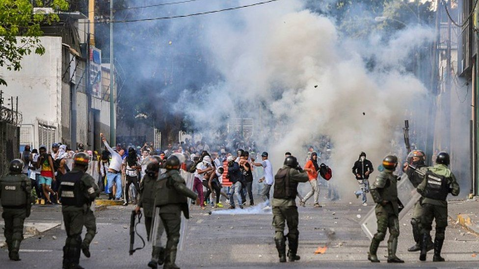 Venezuelan police clash with thousands of protestors