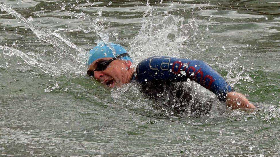 Paul Pester swimming during a triathlon