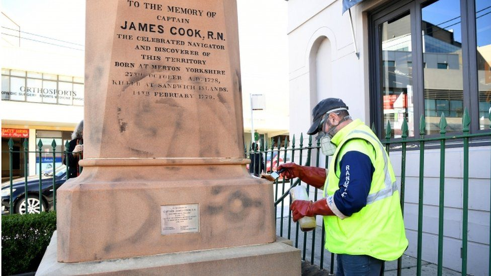 Protesters scrawled graffiti on a statue of Capt Cook in Sydney
