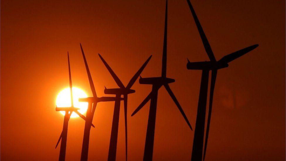 Sun setting over wind turbines near Faringdon, Oxfordshire