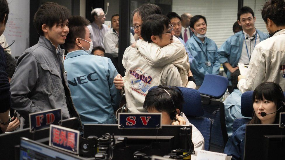 Control room in Sagamihara celebrates as the spacecraft touches down on February 22, 2019
