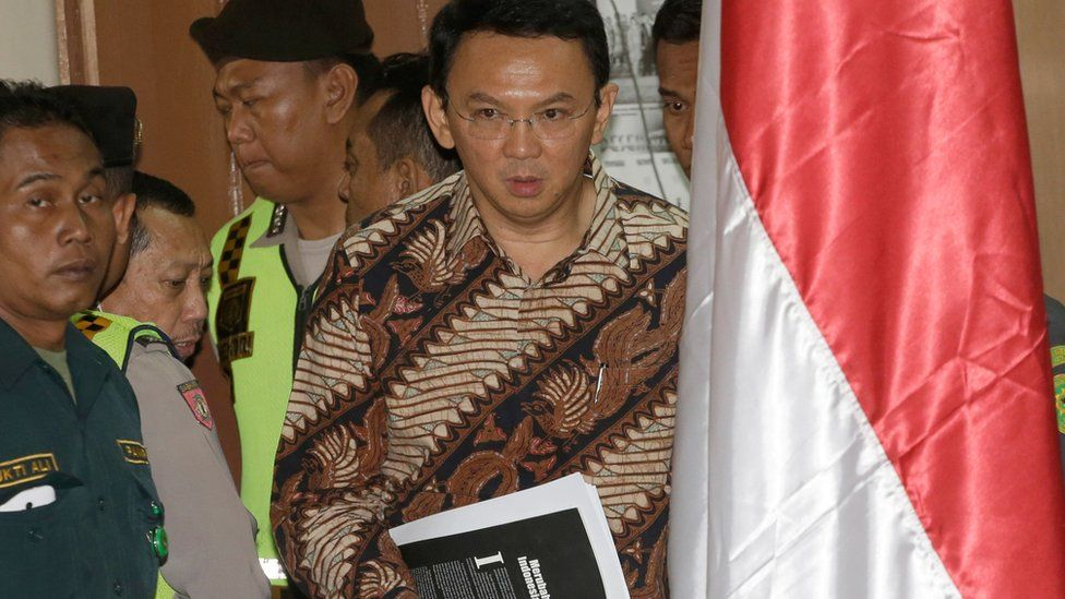 Jakarta Governor Ahok enters the courtroom before his blasphemy trial