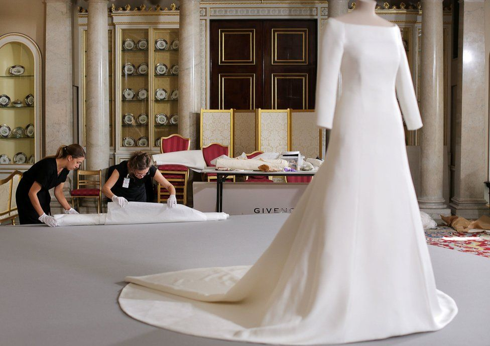 Conservators from the Royal Collection unwrapping the veil of the Duchess of Sussex's wedding dress