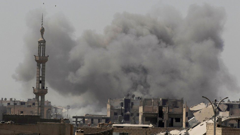 Smoke rises after an air strike during fighting between members of the Syrian Democratic Forces and Islamic State militants in Raqqa, Syria (20 August 2017)