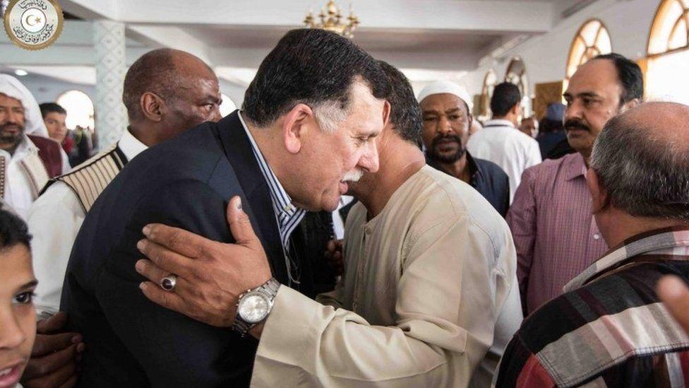 Fayez al-Sarraj being greeted at a mosque in Tripoli