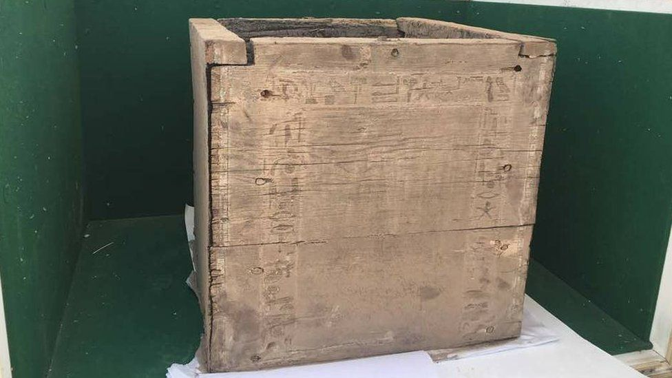 Photograph published by the Egyptian ministry of antiquities showing a wooden box found inside a burial chamber at the Dahshur royal necropolis, south of Cairo (10 April 2017)
