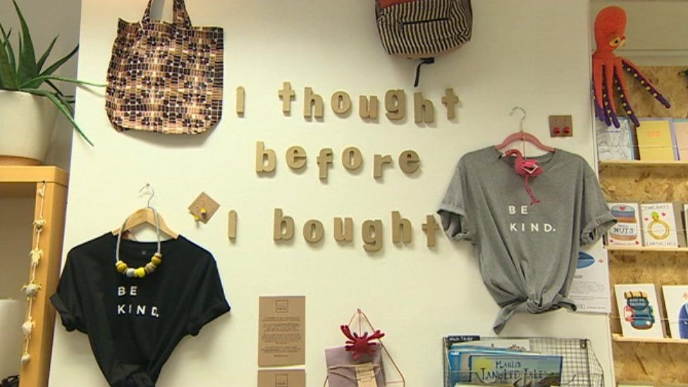 A wall inside the Ripple store which says 'I thought before I bought'