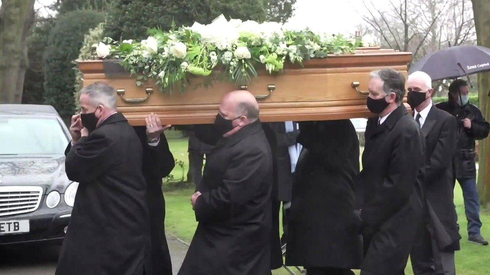 Coffin carrying Colin Bell taken into his funeral