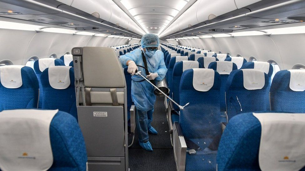 Member of Vietnam Airlines staff disinfects aircraft after flight - 4 February