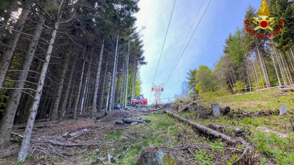 Image from Italian Fire and Rescue Service shows Rescuers at work at the area of the cable car accident, near Lake Maggiore, northern Italy, 23 May 2021