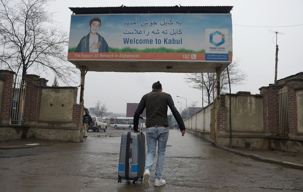 An Afghan refugee who was deported from Germany arrives with his belongings at the international airport in Kabul on January 24, 2017.
